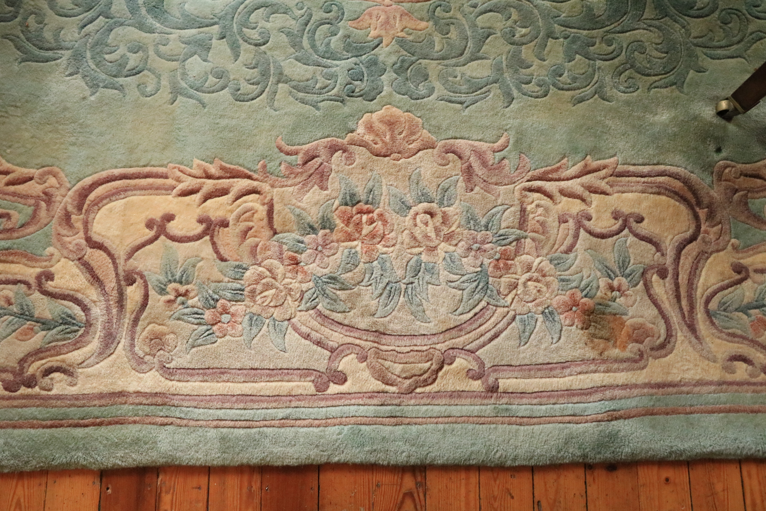 A Chinese Kayan Carpet, the lime green ground with central floral medallion inside a conforming - Image 2 of 4