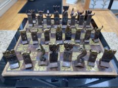 An attractive and unique hand made gilded iron Chess Set, modelled in the mythical Celtic style,