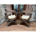 A pair of attractive X framed carved oak Armchairs, in the Renaissance style, with grotesque masks