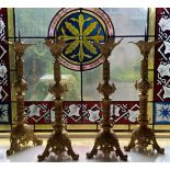A fine set of 4 Gothic Revival brass Pricket Candlesticks, each with a leaf cast flared top above