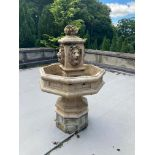A very attractive composition stone Garden Fountain, with basket of fruit finial above four lion