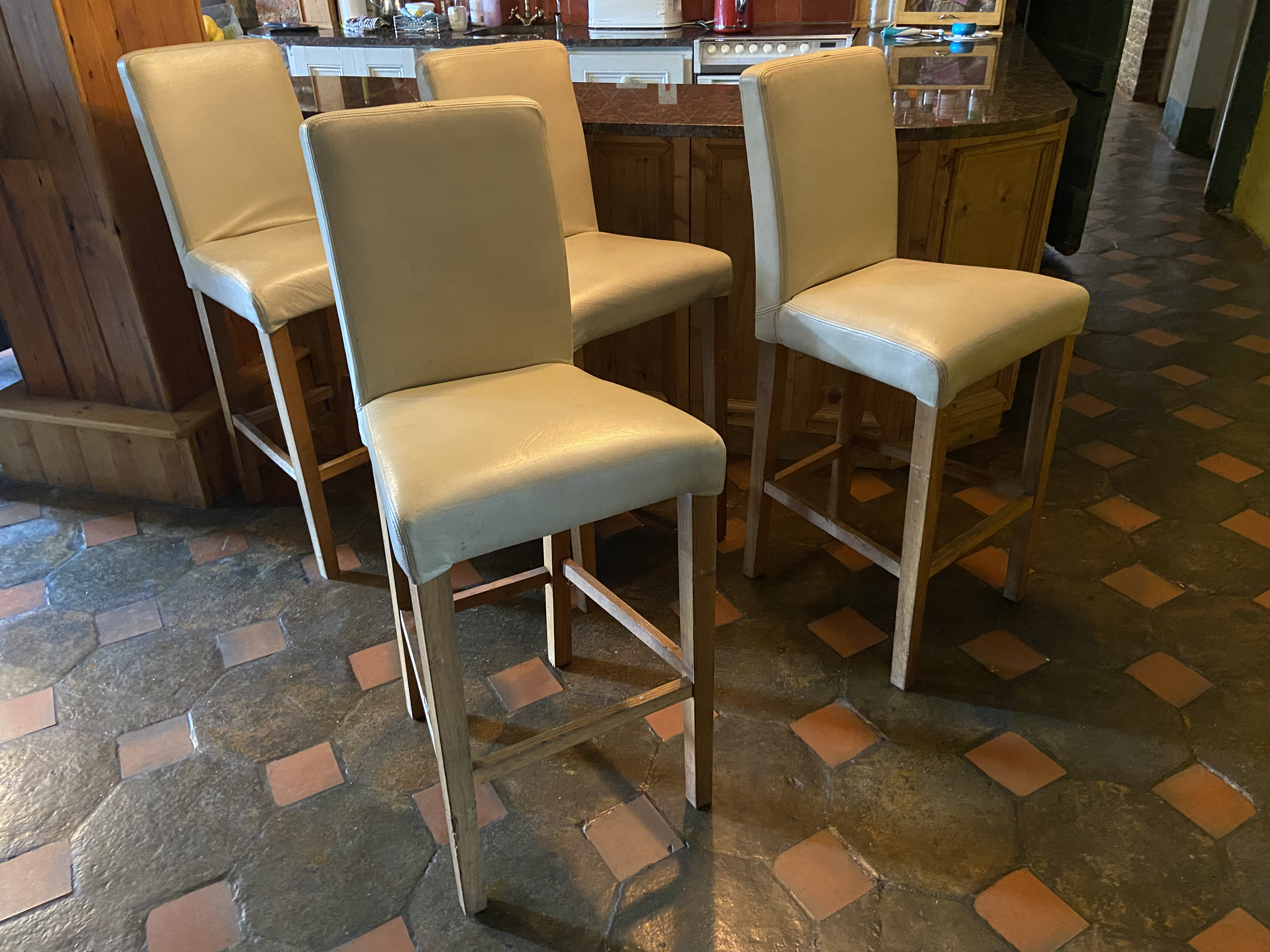 A set of 4 cream covered high Kitchen Bar Stools. (4)