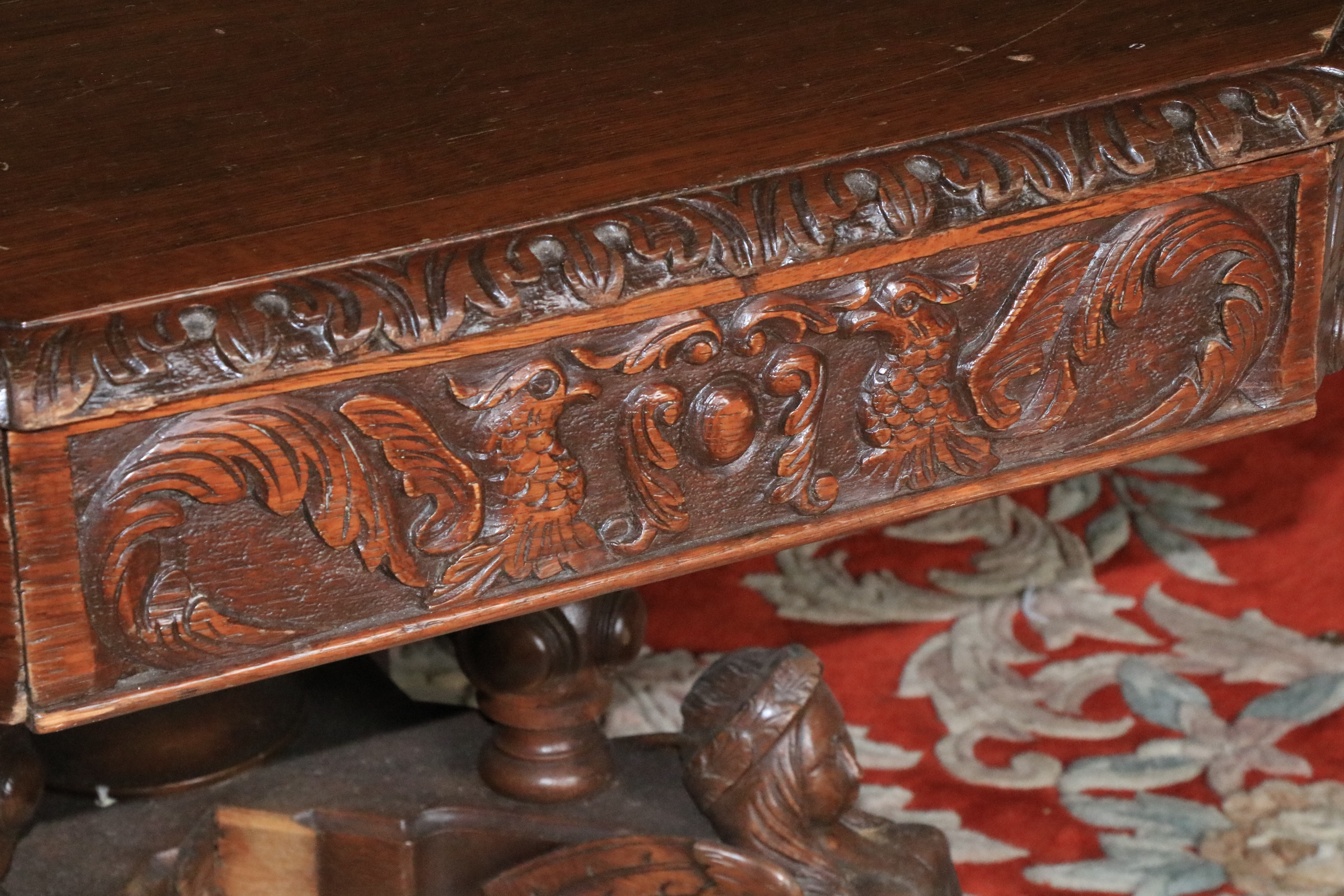 A Victorian carved oak Library Drum Table, with octagonal top above four mock and four frieze - Image 2 of 3