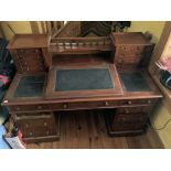 A Victorian mahogany'Dickens' Desk, in the manner of Strahan, with gallery back over a leather