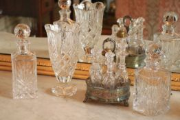 A Waterford crystal Vase, 10'' (25cms), together with two similar square glass Decanters and a