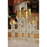 A pair of heavy Art Glass multi gourd Candle Stands, 17'' (43cms); together with a pair of smaller