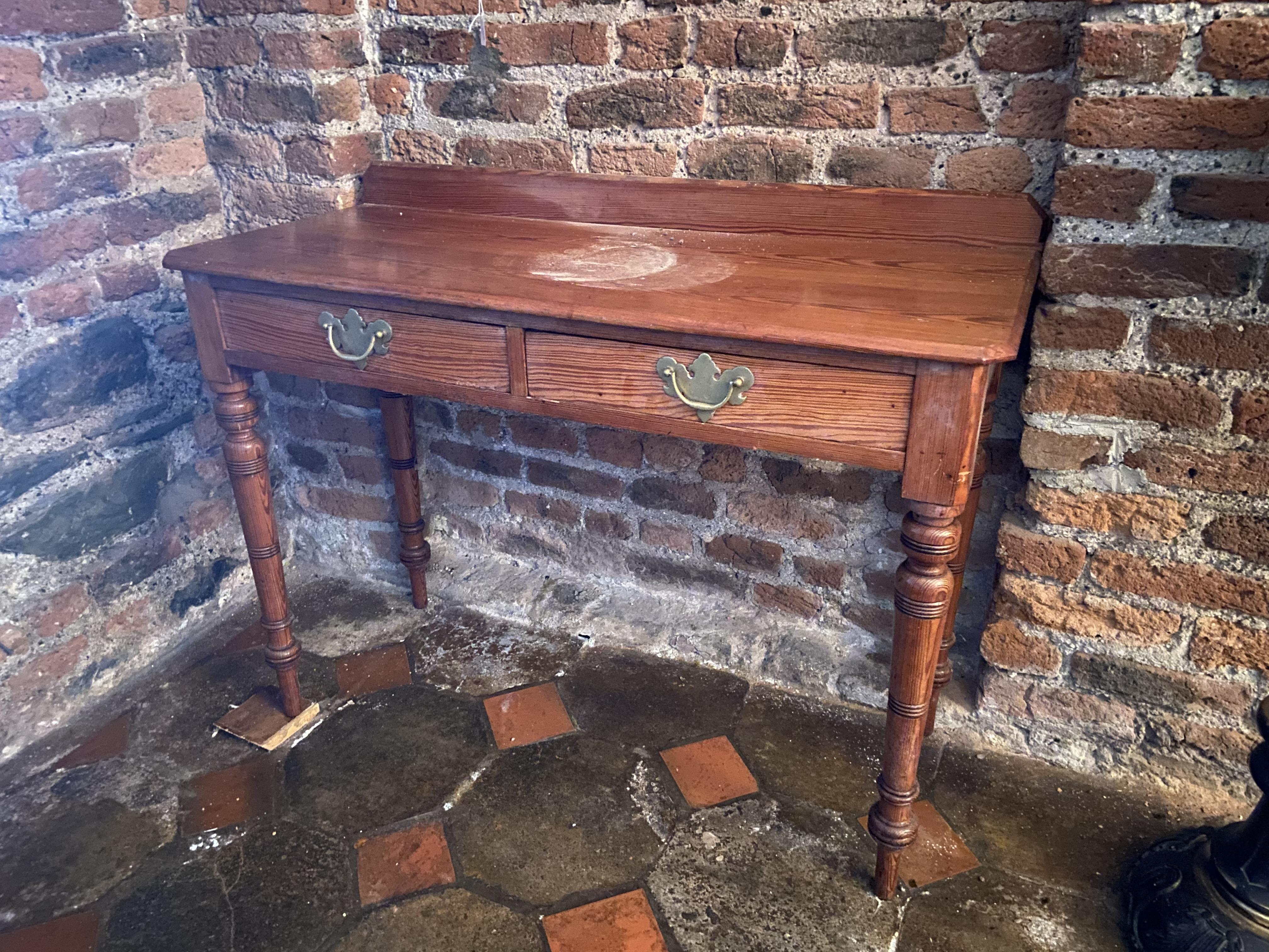 A Victorian pitch pine Side Table, with two frieze drawers on turned legs, 41'' (104cms). (1)