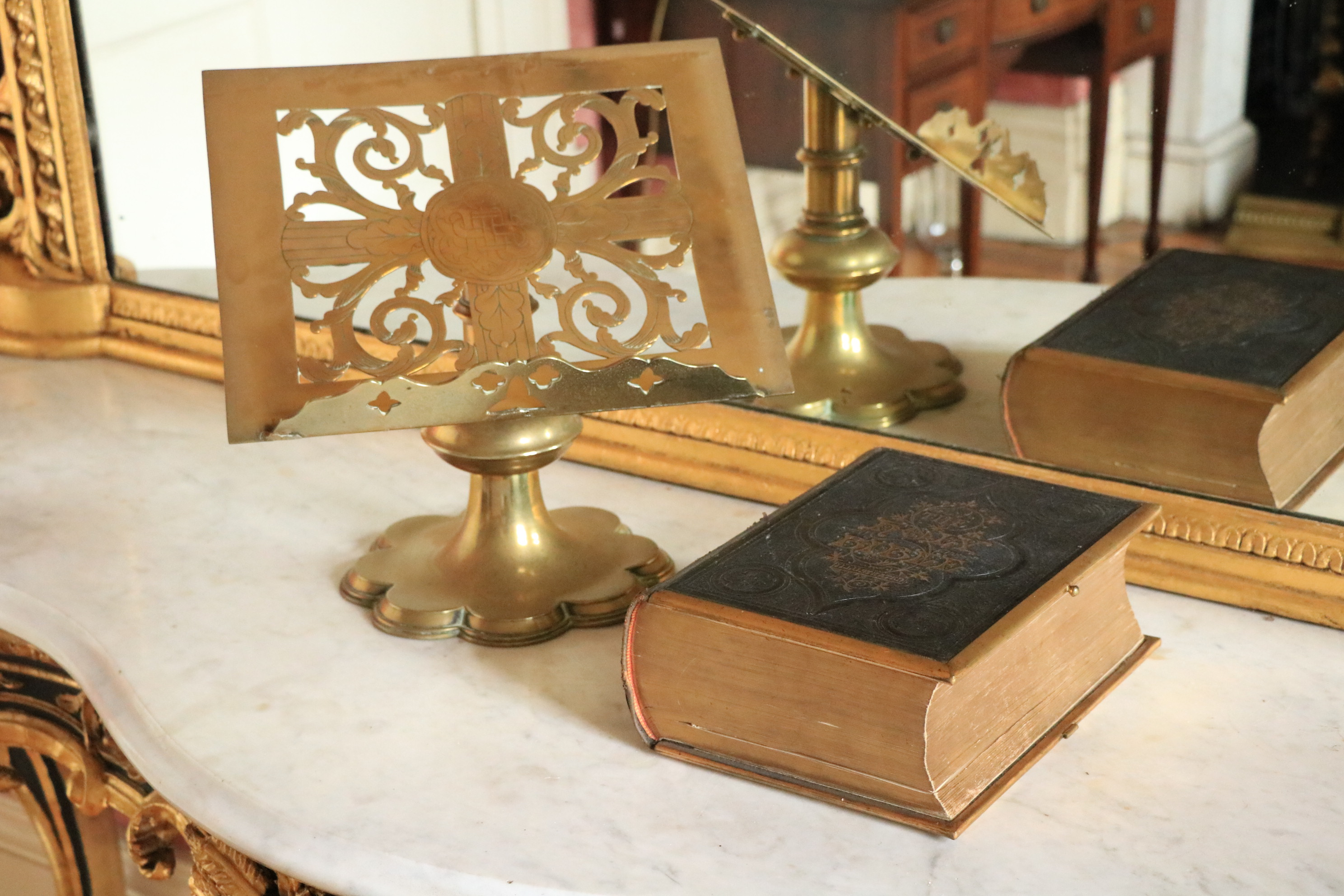 A 19th Century pierced brass slope top Bible Stand, with cruciform design on a single knob stem 12