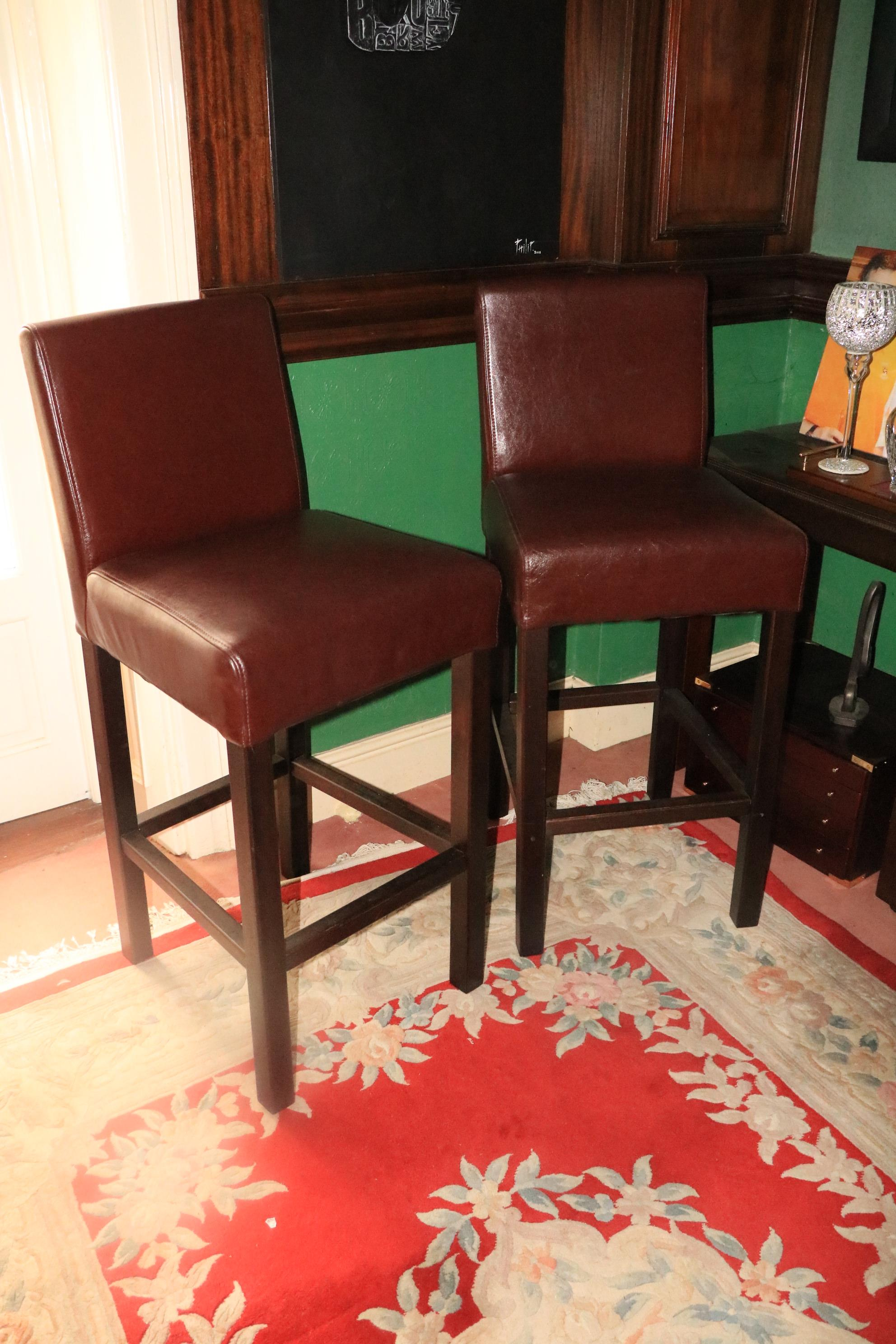 A good set of five large upholstered Bar Stools, covered in brown hide. (5)