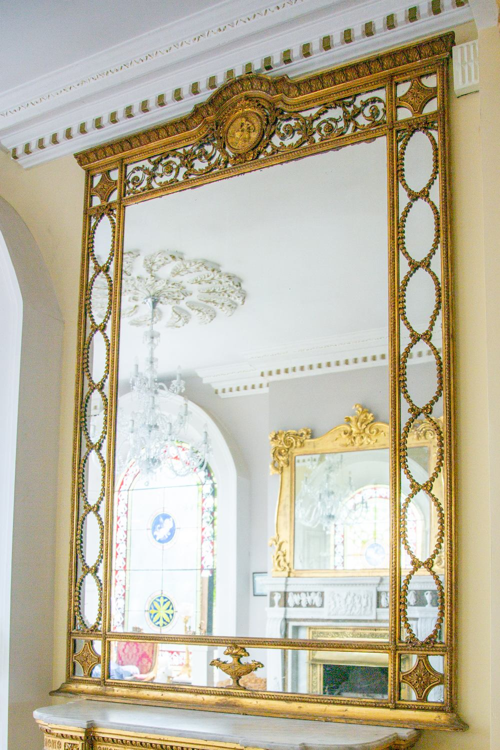 A fine 19th Century Regency style giltwood Wall Mirror or Overmantel, the arched and leaf moulded