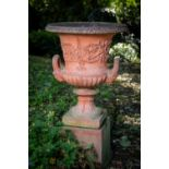 A very good pair of compona shaped terracotta Garden Urns, each with egg and dart folded rim above a