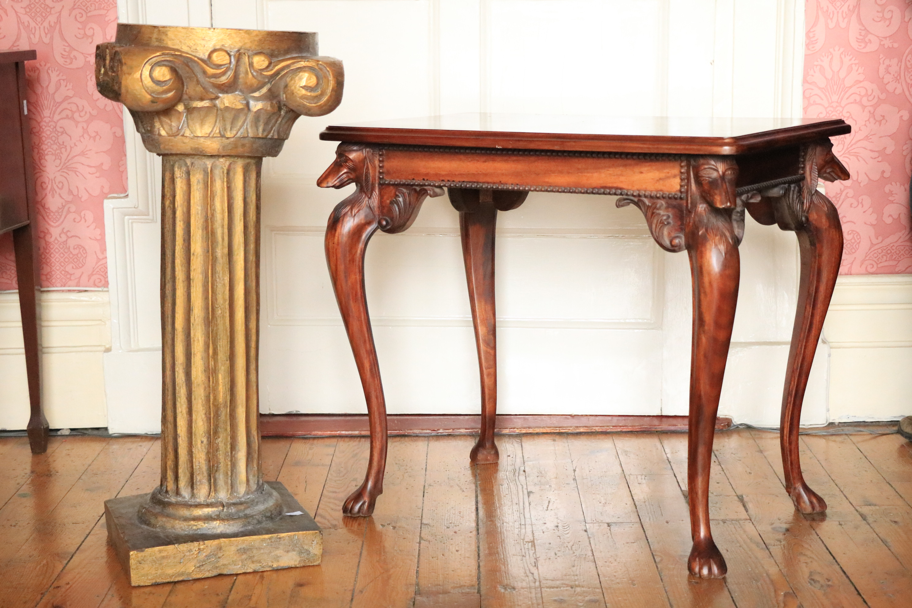 A rectangular mahogany Occasional Table, the moulded top above four greyhound heads on cabriole legs