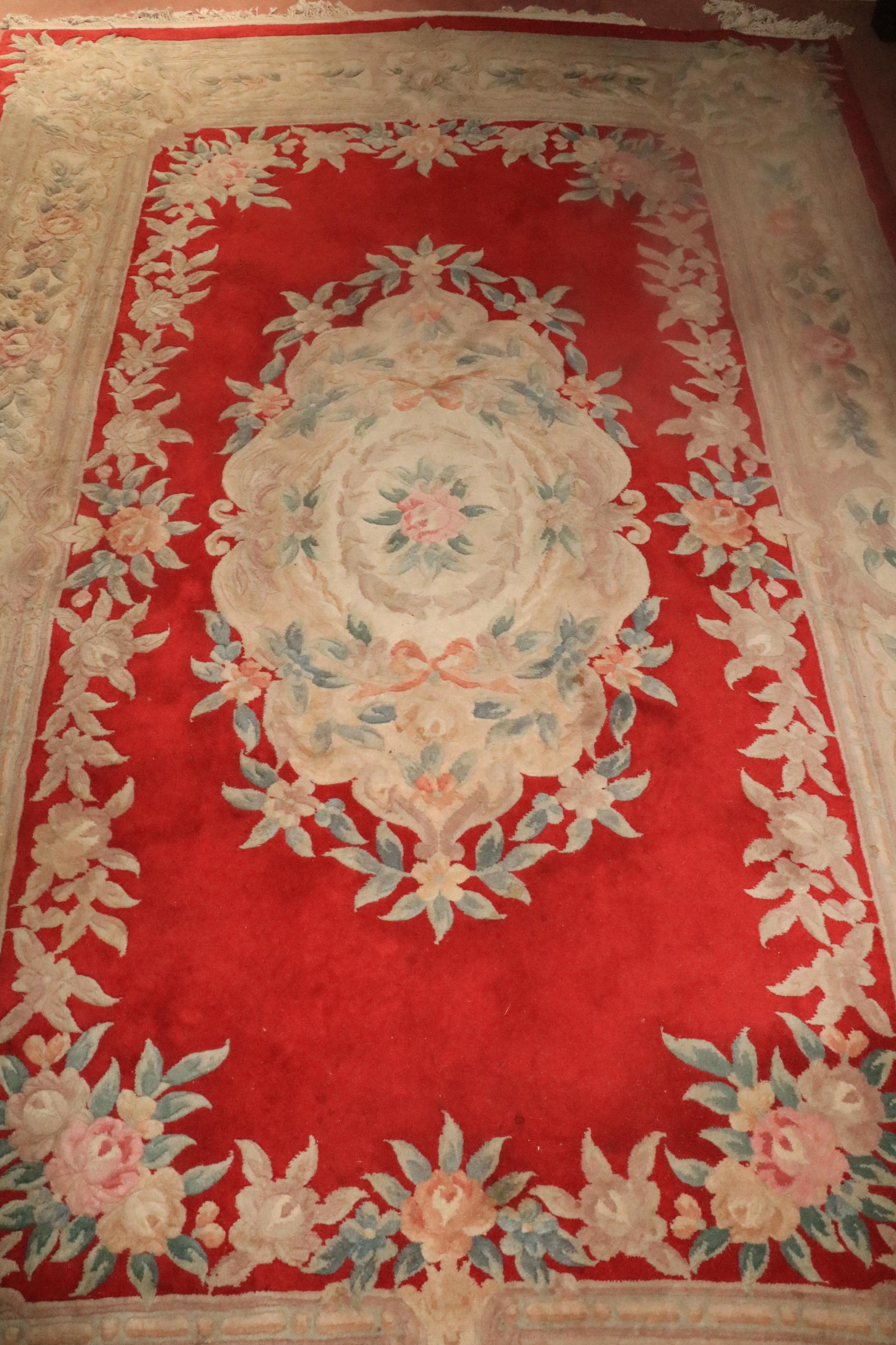 A heavy Chinese Rug, the centre red ground surrounded by a large floral border and similar decorated - Image 2 of 3