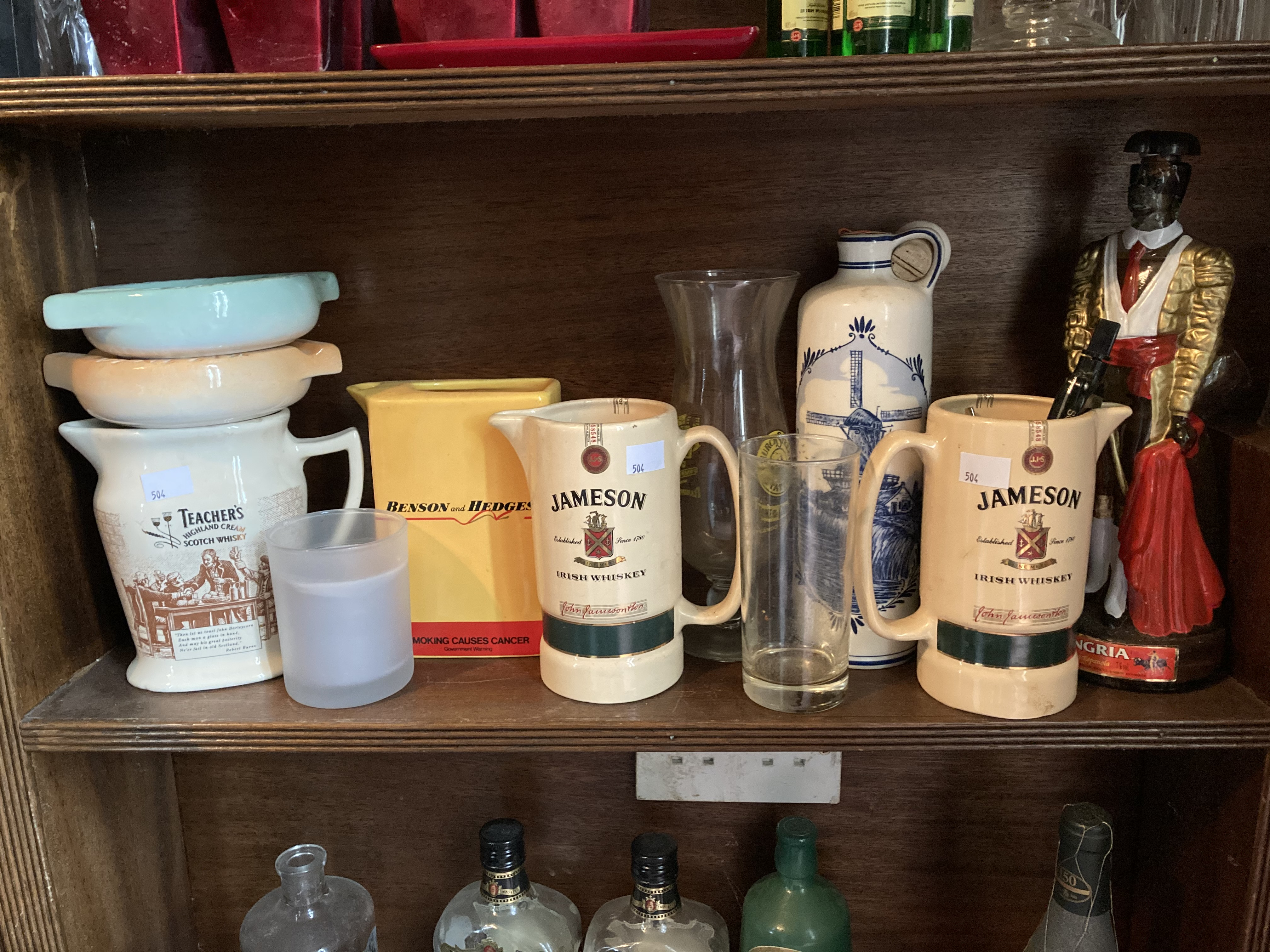 A collection of Jugs, Ashtrays, all labelled Jameson, Teachers, Benson & Hedges, Guinness Bucket,