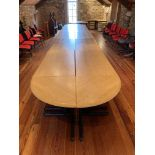 A very large modern grained pine Boardroom Table, in 14 sections, one with two bow ends on coated
