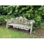 A pair of heavy cast iron Garden Benches, each rustic open work back with scrolling oak leaves above