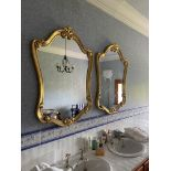 A pair of cartouche shaped gilt Mirrors, each in scroll moulded frame, 43'' x 21'' (109cms x 79cms).