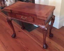 A Chippendale style fold-over mahogany Games Table, for backgammon, chess and draughts, with