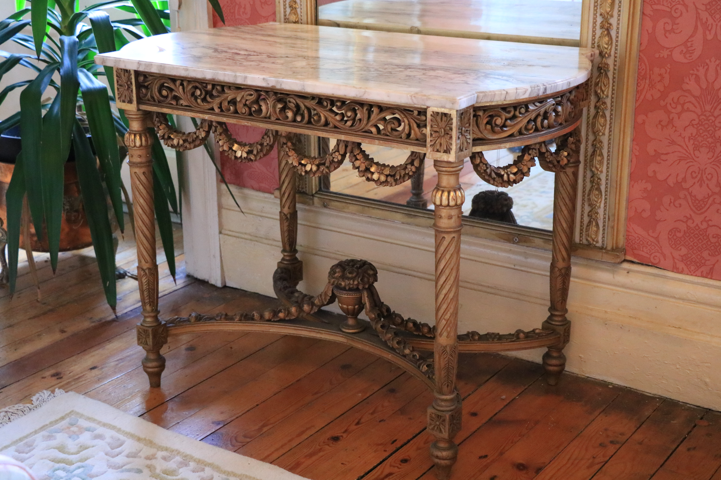 A French giltwood Centre Table, with white veined marble top with bowed ends above a pierced and