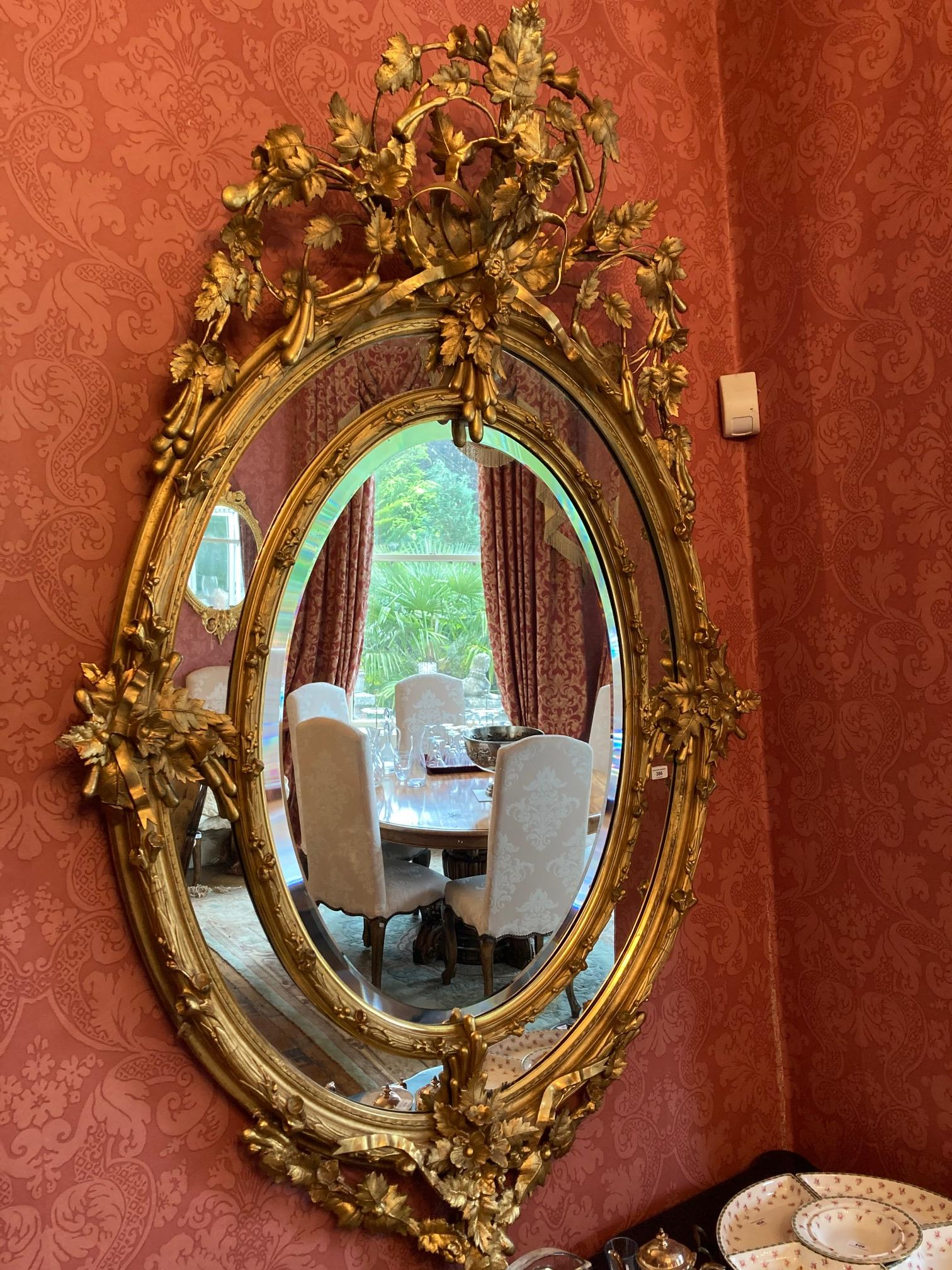 A superb large 19th Century oval gilt Wall Mirror, the ornate crest with scrolling foliage and - Image 7 of 7
