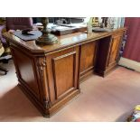 A good Georgian style mahogany kneehole pedestal Desk, the rectangular top with canted corners and