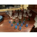 Eight similar Shot Glasses; and a miscellaneous collection of coloured Glasses. (a lot)