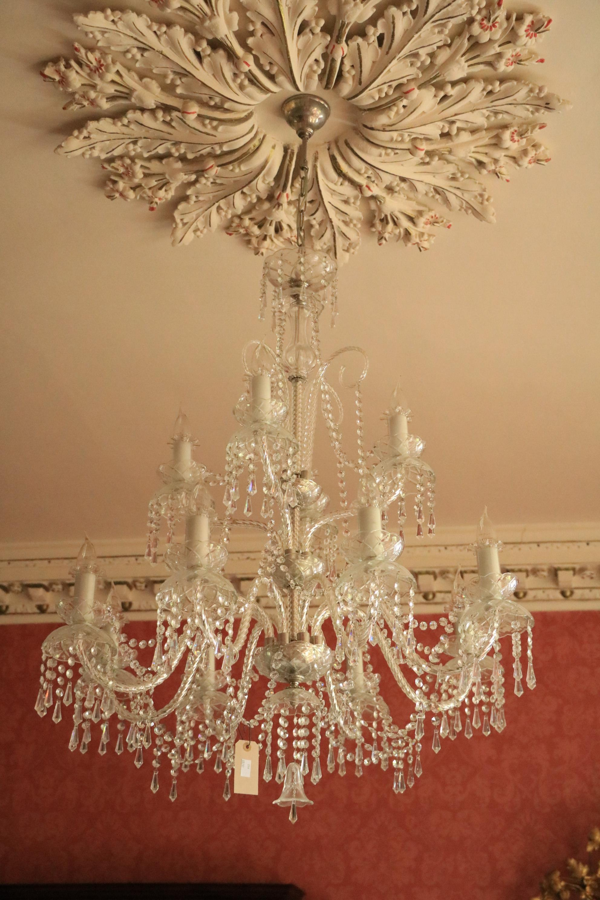 An extremely attractive twelve branch crystal Chandelier, with 8 lower arms and 4 upper arms, with
