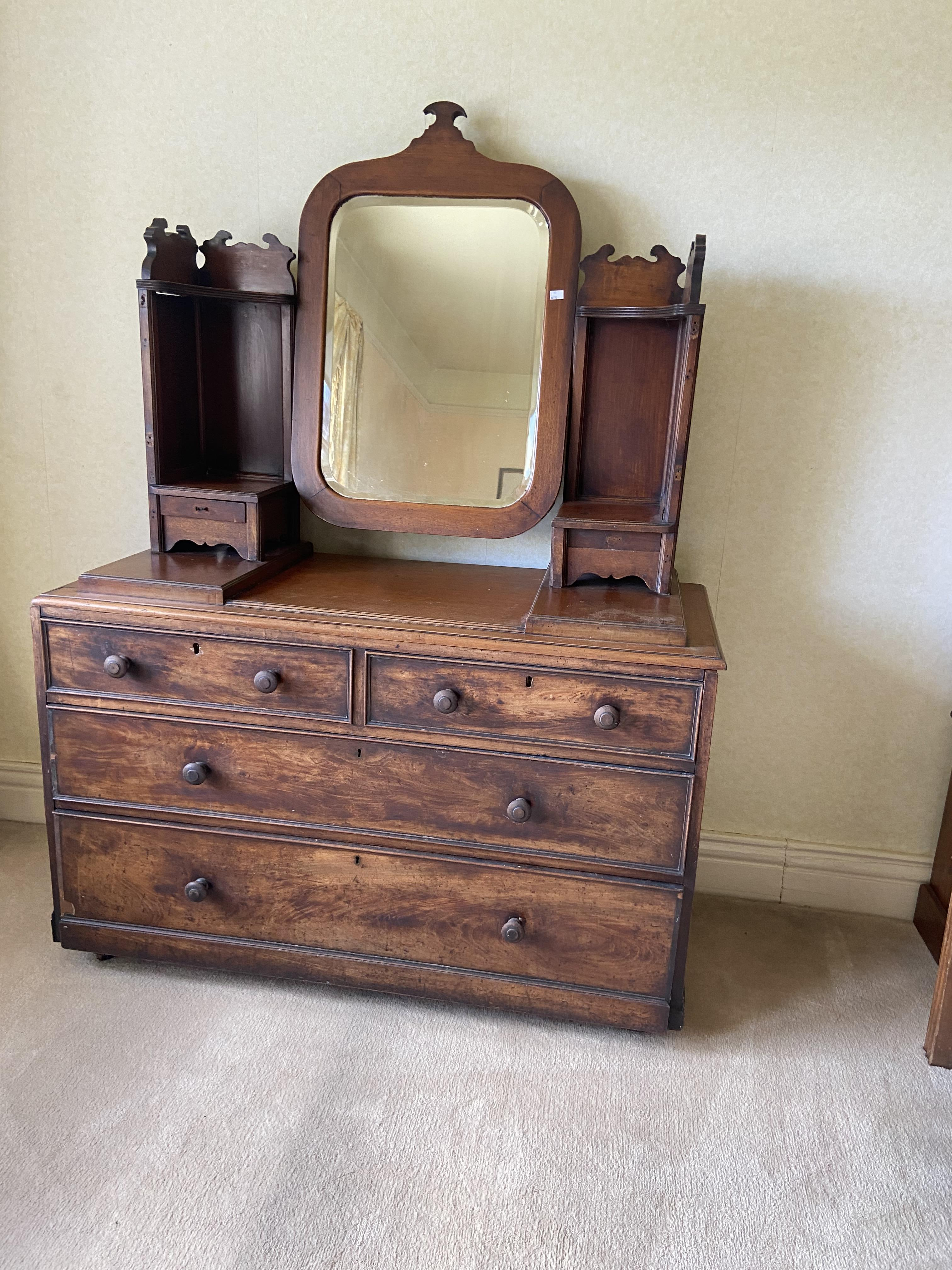 A 19th Century mahogany four drawer Chest, adopted, now with swing frame mirror and two brackets,