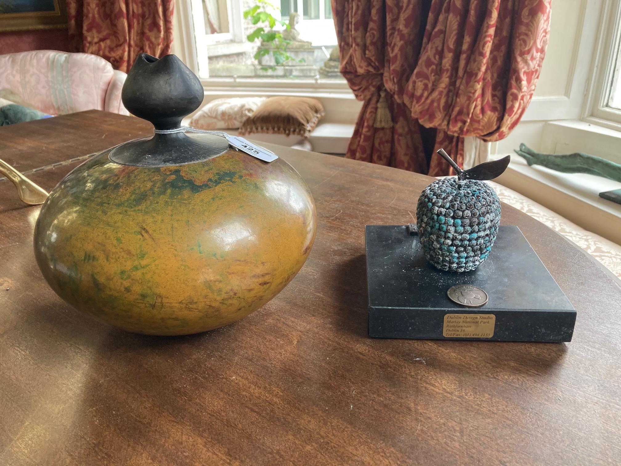 An Art Pottery bulbous Vase, 9'' (23cms); and an Art Bronze Fruit form on limestone base. (2)