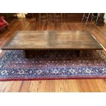 A large rectangular plank top rustic low Occasional Table, on rectangular plank supports, 79'' x