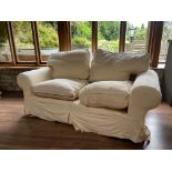 A 2 piece Suite of Seat Furniture, comprising a two seater Settee, covered in ivory loose fabric and