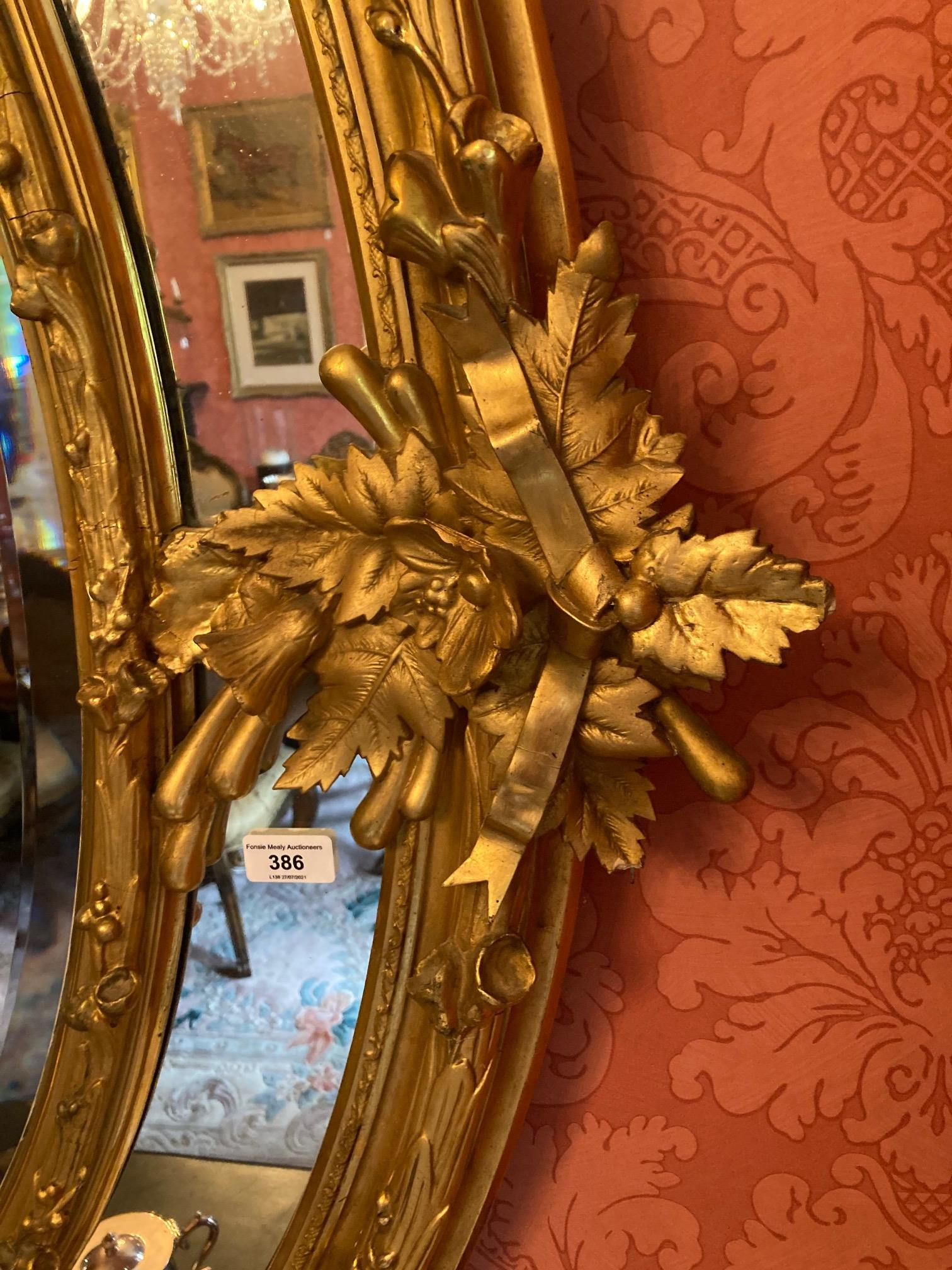 A superb large 19th Century oval gilt Wall Mirror, the ornate crest with scrolling foliage and - Image 2 of 7