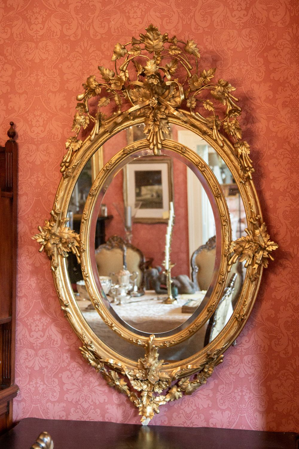 A superb large 19th Century oval gilt Wall Mirror, the ornate crest with scrolling foliage and