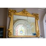 A Victorian carved giltwood Overmantel, with centre leaf crest on a serpentine shaped cornice with