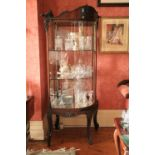 A good and rare pair of late 19th Century mahogany bow fronted Shop Corner Display Cabinets, each