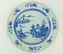 A large circular blue and white Kangshiÿ Charger, with pagodas and residences, and with a figure