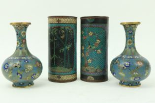 A pair of Chinese cloisonn'ÿenamel Vases, of cylindrical form, decorated with colourful flowers