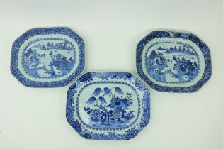 A pair of Nankin blue and white Meat Platters, decorated with figures and residents by a lake;