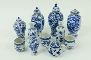 A selection of six blue and white miniature Vases, (four with covers); a miniature blue and white