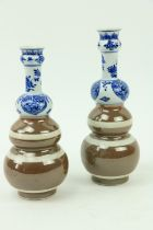 Two similar Xiangshi period (1663 - 1728) tripleÿgourd blue and white Caf'ÿau Lait Vases, with