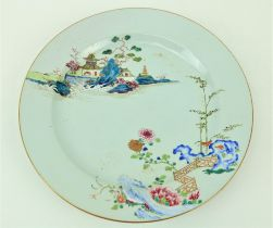 An 18th Century Chinese Famille Verte Charger, decorated with a railed balcony, pagodas and flowers,