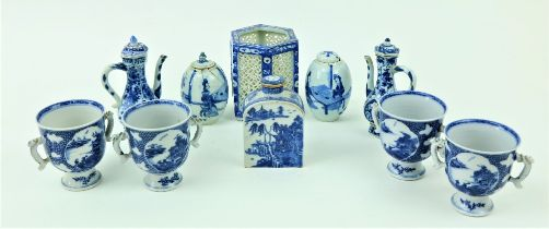 """A set of four two handled blue and white Chinese porcelain Cups, each on stemmed base, 10cms (4"""")"""