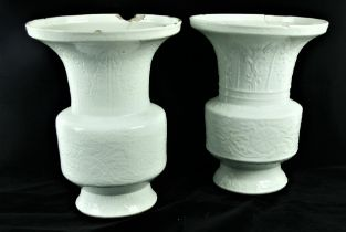 A very rare pair of 18th Century relief moulded Chinese Blanc de Chine Gu Vases,ÿeach decorated in