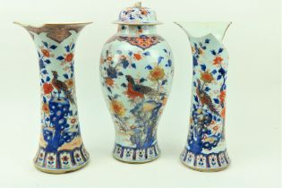 A fine 18th Century Chinese Imari Vase and Cover, of baluster form, decorated with foliage,