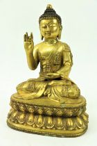 A fine quality large Chinese gilt bronze Figure, of a Buddha, seated on a double lotus base, the
