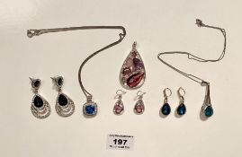 2 dress necklace and earring sets and 1 pendant and earring set