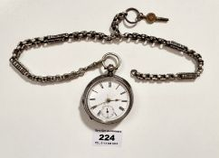 "Silver pocket watch on plated chain, 2"" (5cm) diameter face. Winds and runs."