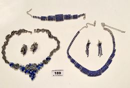 2 sets of blue dress necklaces, bracelets and earrings