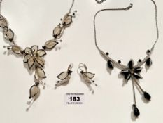 2 dress necklaces and pair of earrings