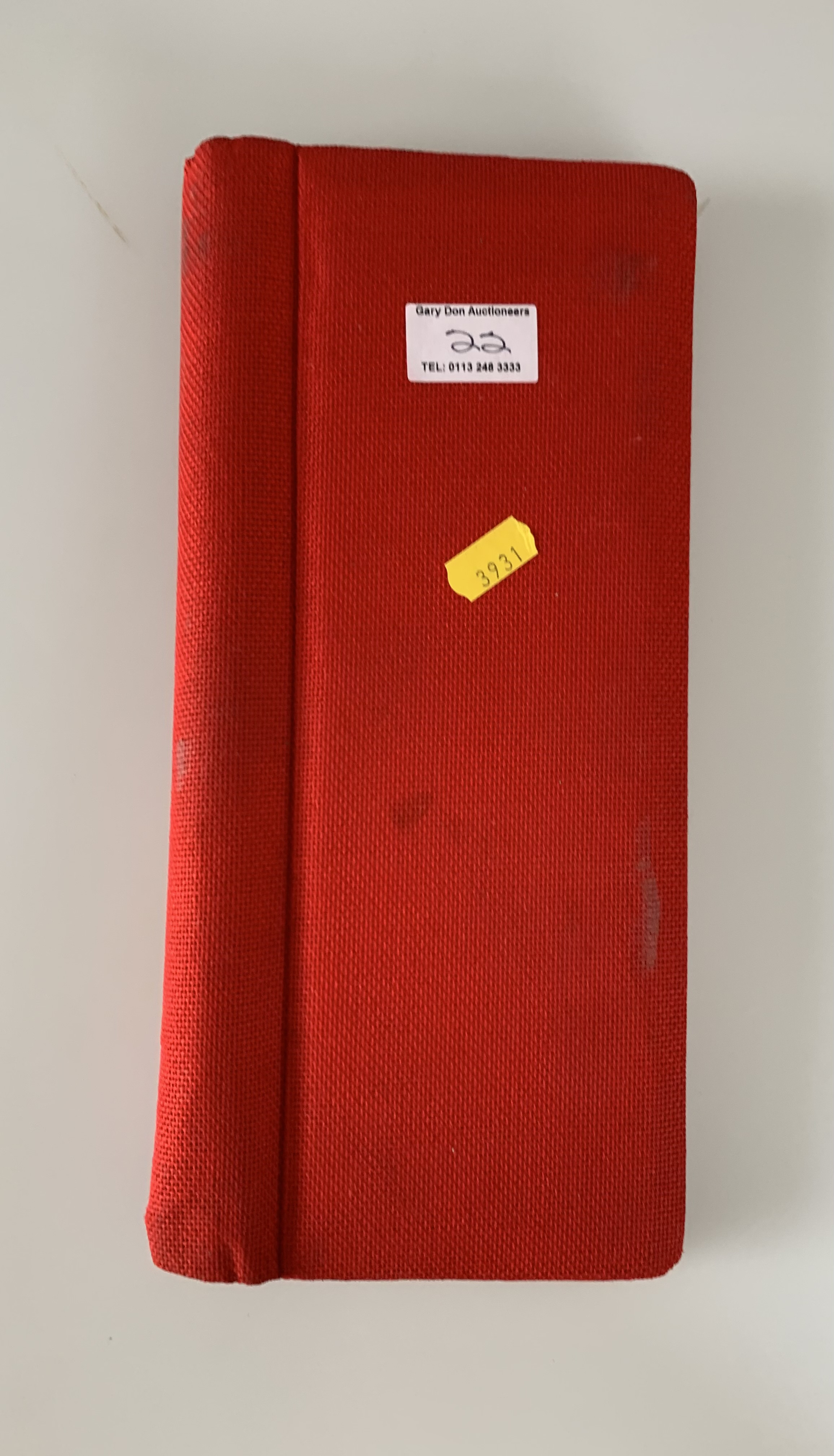 Small red album of world stamps